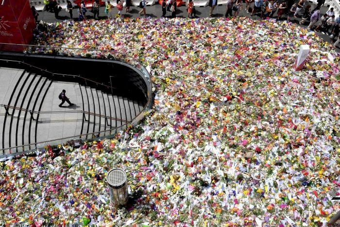 Floral_tributes_for_victims_of_the_Lindt_cafe_siege_laid_in_Martin_Place_-_Sydney_Australia_in_December_2014__Photographed_by_John_Donegan_-_702_ABC_Sydney__